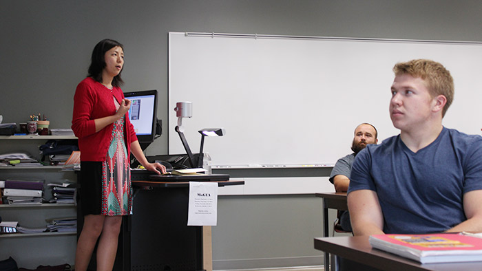 Lara Strong teaching students during a class.