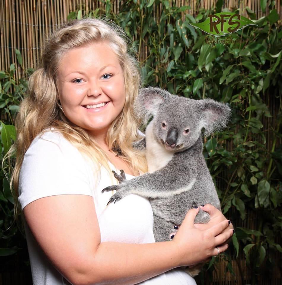 Kenna Sheppard posing with koala bear.