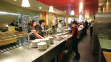 Students go through the campus dining hall line