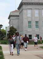 Students walking in front of Hill Hall