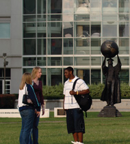 Students near the Citizen Scholar statue